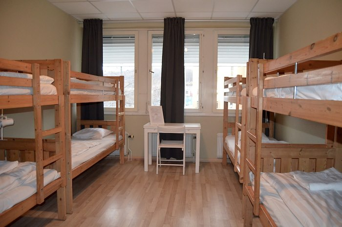 Bed in dormitory for men with 8 beds with shared bathroom