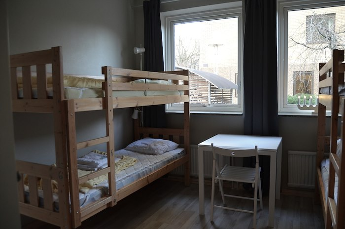 Bed in dormitory for women with 8 beds with shared bathroom